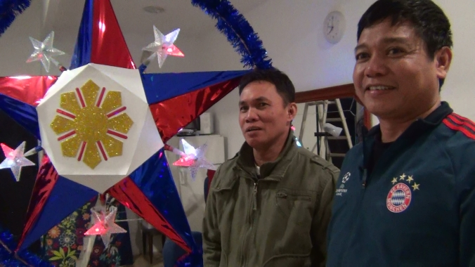 Apalit, Pampanga-native Jerry Santos proud of his Philippine flag-inspired Christmas lantern.